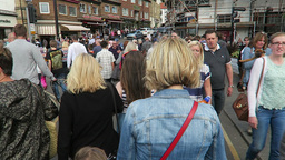 Tourists cross Whitby's swing bridge Footage