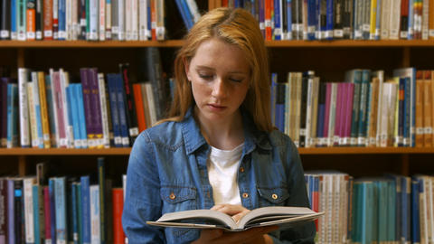 Student studying in a library Footage