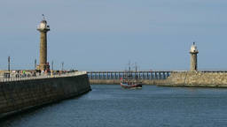 Pirate Boat Enters Whitby Harbour stock footage