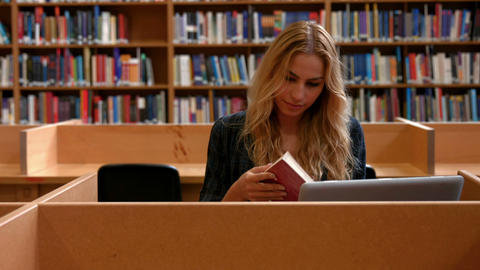 Student working on laptop in the library Footage