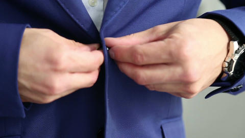 The man fasten the button on his jacket Footage