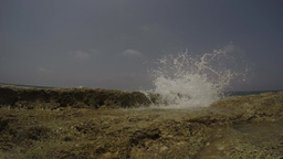 Water splashing over a Rock, real time Footage