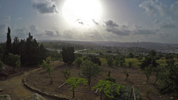 Gloomy sunshine and moving clouds and Jerusalem with some nature - time lapse Footage