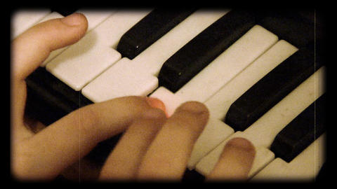 child play at toy piano as reel movie Footage