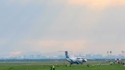 Airplane taxiing on runway Live Action