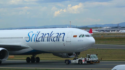 Towing SriLankan Airbus stock footage