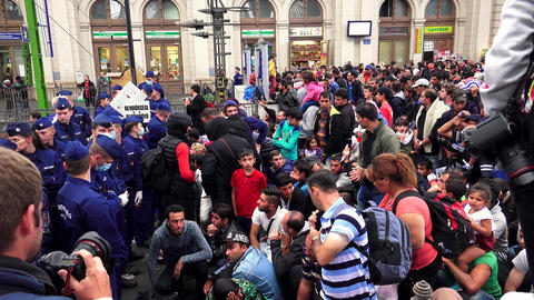 Immigrants and refugees at the railway station in Budapest. 4K Live Action