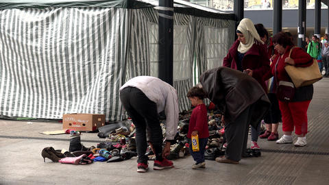 Immigrants and refugees dismantled clothes and warm clothes at the railway stati Live Action