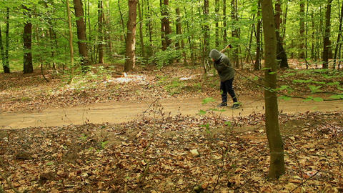 Creepy axeman walking through the forest with an axe Live Action