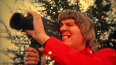 BALTIMORE, MARYLAND 1973: Women cinematographer with Super 8 film camera enjoyin Footage