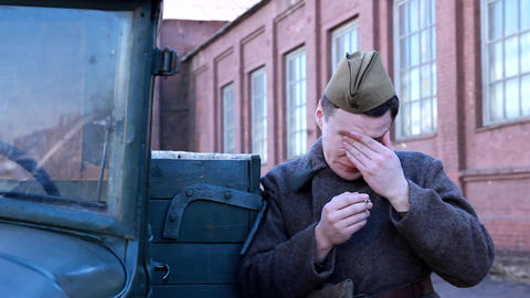 Russian Soldier Smokes About War Machine.1941-1945 stock footage