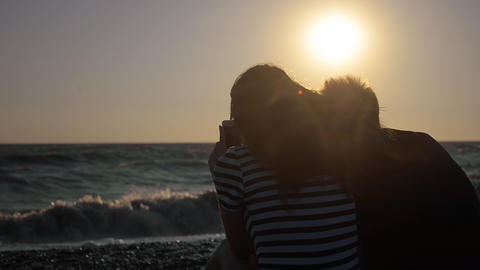 Silhouette Of Couple On The Beach Looking Out To Sea Footage