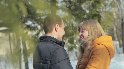 Romantic couple talking and laughing in forest Footage