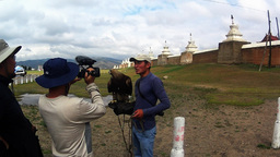 Mongolian provincial TV interviews the owner of an eagle at the walls of the old Footage