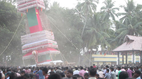 indian men carry and swing giant construction with God statue Footage