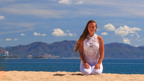 blonde girl in lace maditates in yoga asana sits on knees Footage