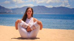 blonde girl in lace meditates in yoga asana fetus Footage