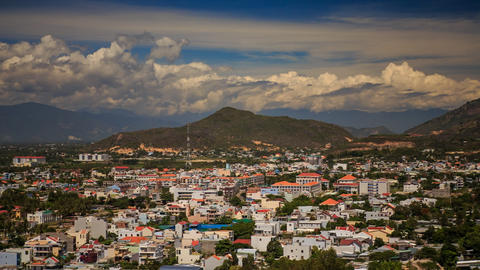 view of Vietnam resort city against mountains clouds blue sky Footage