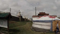 White Mongolian yurt near the ancient walls of a Buddhist monastery Footage