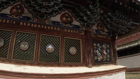 colorful wall decorations in the ancient Buddhist temple close up Footage