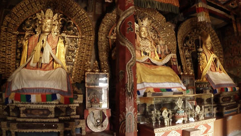 Three Golden Buddha statue inside a Buddhist temple ancient Archivo