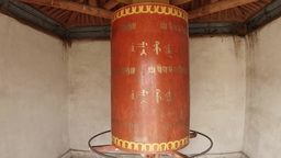 ancient Buddhist prayer wheel slowly reel spinning mantras in Sanskrit inscripti Footage