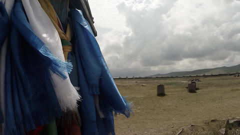 Long Prayer Blue Flags Flutter In The Wind At A Buddhist Monastery In Column stock footage