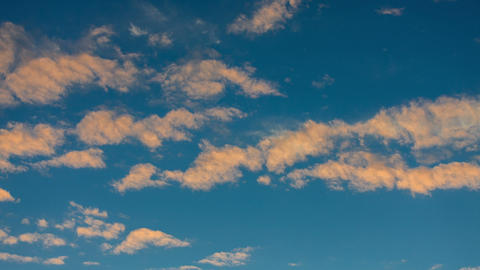 Golden Clouds on the Background of the Sunset Sky Stock Video Footage