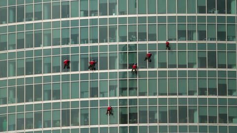 climbers on a skyscraper Stock Video Footage