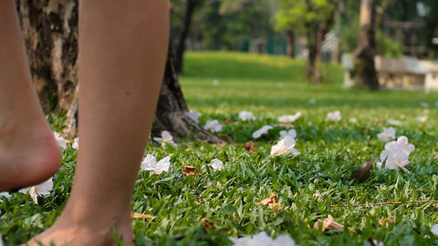 woman walking on the grass Stock Video Footage