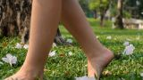 Woman Walking On The Grass stock footage
