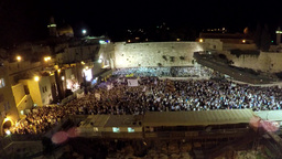Masses of people by night at the western wall (time lapse) Footage