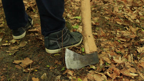 Close up of an axe dragging along the ground Live Action