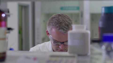 Man Working As Science Researcher People Staff Health Care Hospital Footage