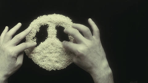 symbol hippies made by man's hands on the table of cereals, retro, vintage Footage