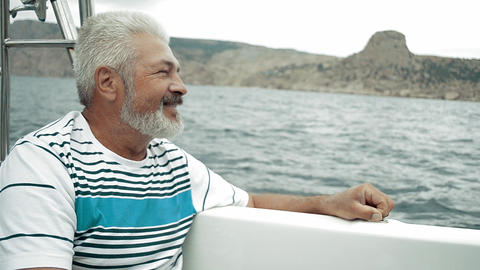 Senior Man Sitting On Boat Looking To The Sea stock footage