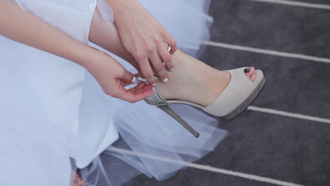 Bride puts on her wedding shoes Footage
