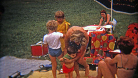 MONTREAL, CANADA 1975: Mod colorful family picnic from French Canadians outside  Footage
