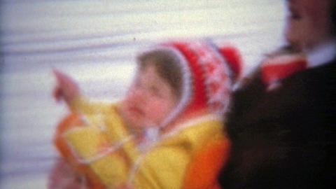 MONTREAL, CANADA 1975: Family dangerously winter snow sledding with young son Footage