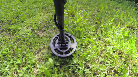 POV shot of metal detecting on lawn Live Action