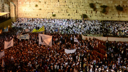 Masses of people by night at the western wall (fast moving) Footage