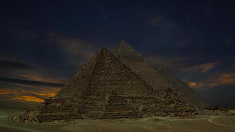 sunset clouds over pyramids at Giza, Egypt, 4k Footage