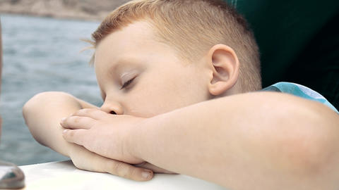 The Boy Looks At The Sea And Falls Asleep Footage
