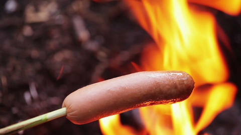 Grilling Sausage On Fire 1 stock footage