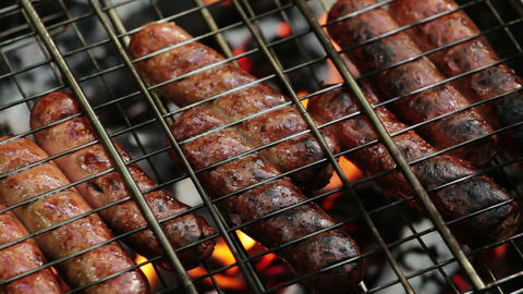 grilling sausages on a barbecue grill Footage