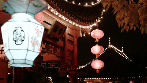 chinese kiosk at night with blurred lantern in foreground Footage