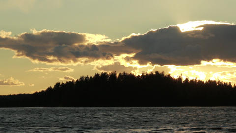 Sunset lake with dark clouds in horizon Live Action