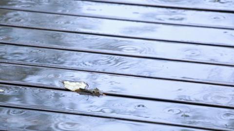 Raindrops falling on wooden balkony Footage