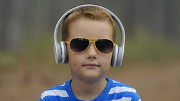 Little Boy Listening To The Music Outdoor Footage
