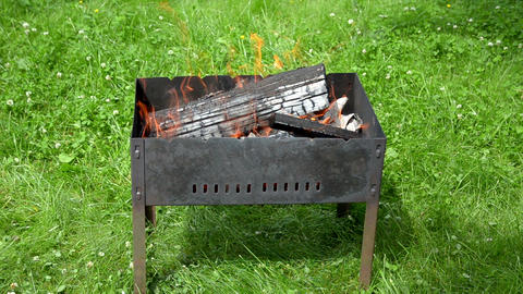 View of the fire tongues in the garden barbecue Footage